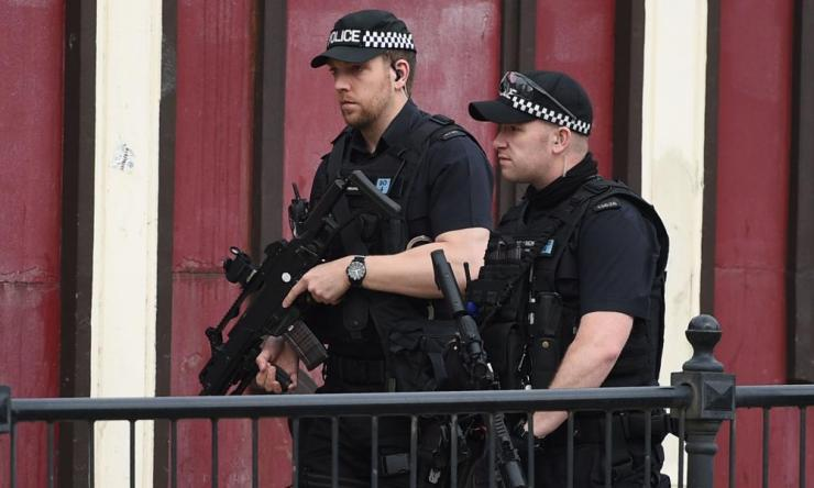 Armed police patrol near Victoria station this morning.