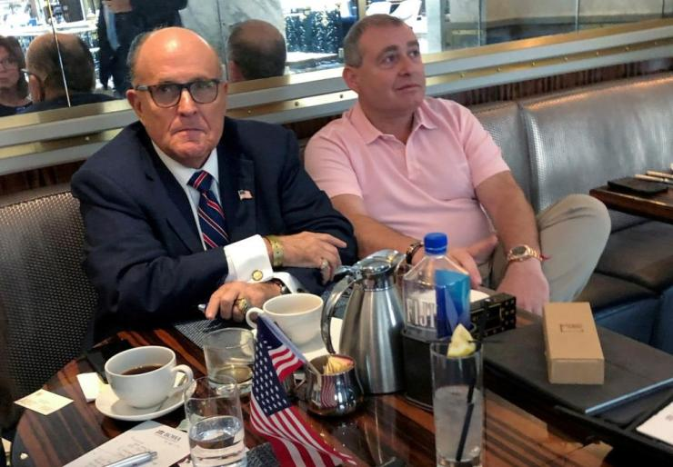 Pass the Tums. Rudy Giuliani and Lev Parnas at the Trump International Hotel in Washington last month