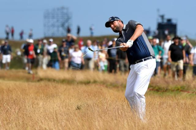 Leishman plays out of the rough on the 4th.