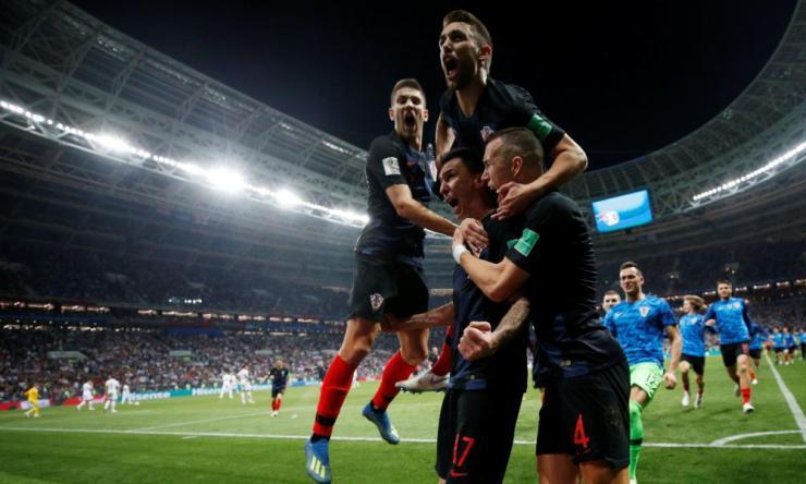 Croatia's Mario Mandzukic celebrates scoring their second goal with team-mates.