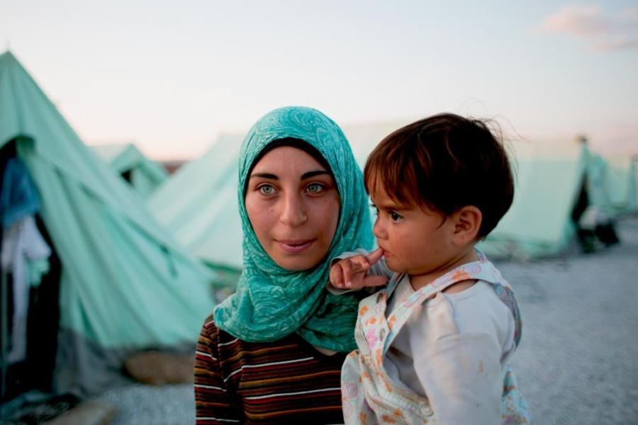 A mother hold her child in a military camp called Softex