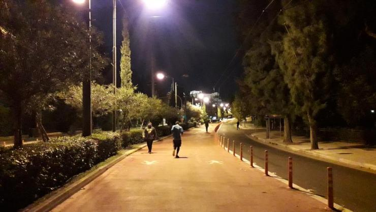Athenians exercising at night beneath the Acropolis.
