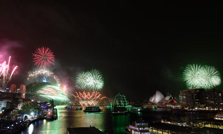 Fireworks explode to welcome in the New Year over the Sydney Harbour Bridge and the Sydney Opera House.