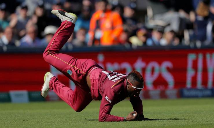 Fabian Allen of West Indies catches out Chris Woakes of England.