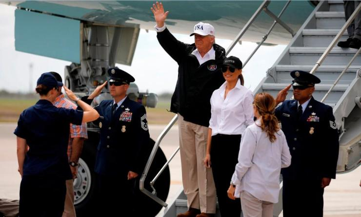 Donald Trump waves next to first lady Melania Trump upon arrival in Corpus Christi, Texas.