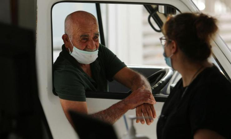 A Turkish Cypriot man wearing a face mask is seen at the Ayios Dhometios checkpoint in Nicosia.