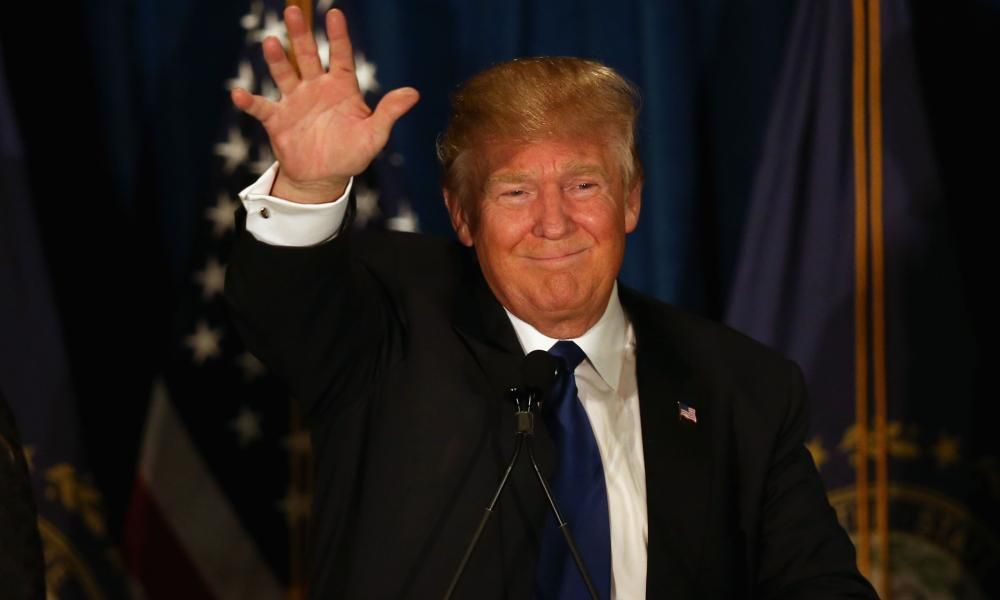 Donald Trump waves to his supporters after primary day at his election night watch party.