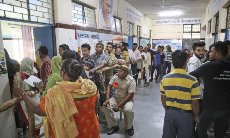 Indians wait to cast their votes in New Delhi on 12 May.