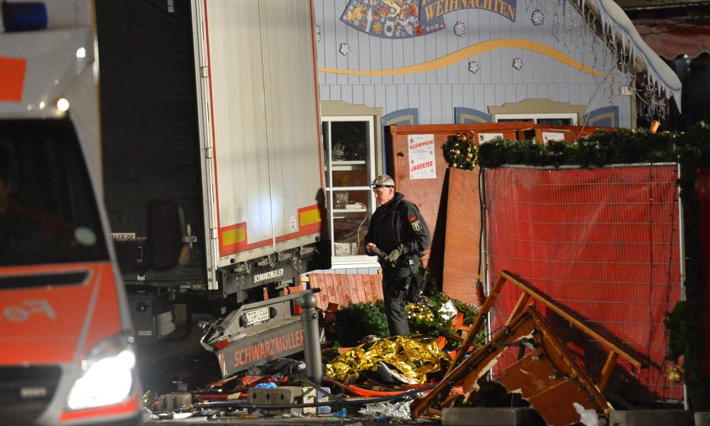 A policeman inspects the truck that crashed into a Christmas market in Berlin.