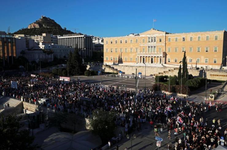 Members of the communist-affiliated trade union PAME attend a demonstration against government plans to regulate street protests, in front of the parliament building in Athens.