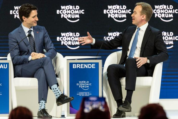 World Economic Forum 2018 in Davosepa06468389 Prime Minister of Canada Justin Trudeau (L) and Borge Brende (R) from Norway, President and Member of the Managing Board of the World Economic Forum, WEF, during a plenary session during the opening day of the 48th Annual Meeting of the World Economic Forum, WEF, in Davos, Switzerland, 23 January 2018. The meeting brings together entrepreneurs, scientists, corporate and political leaders in Davos from 23 to 26 January. EPA/LAURENT GILLIERON