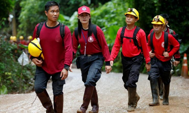 Rescue workers arrive at the Tham Luang cave complex ahead of the mission to free the boys and their coach from the cave.