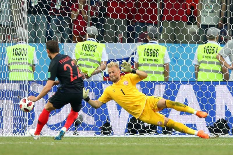 Schmeichel gets down to save from Pivaric.