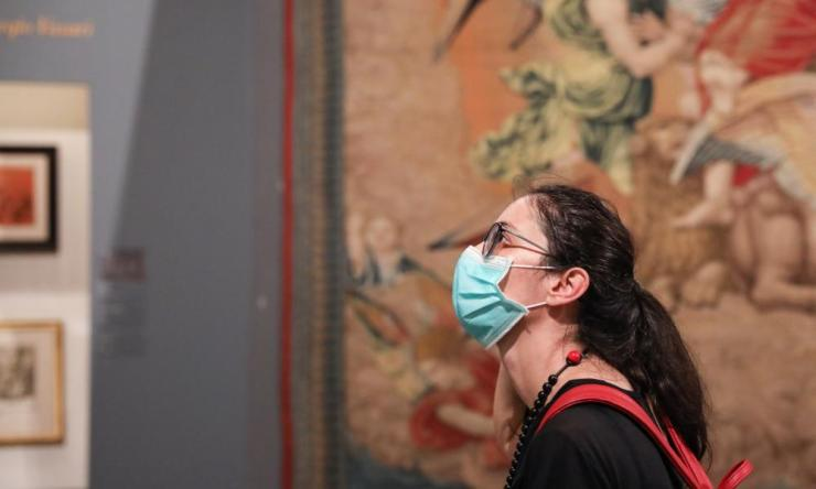 "A woman wearing a face mask visits the exhibition ""Raffaello 1520-1483"" in Rome. The ""Raffaello 1520-1483"" exhibition, the largest-ever retrospective of the life and work of Renaissance maestro Raphael, reopened to public recently at the Scuderie del Quirinale in Rome. Visitors, who had to wear face masks, were required to reserve precise entry times. Each visitor had his or her temperature taken by a digital thermometer upon entry."