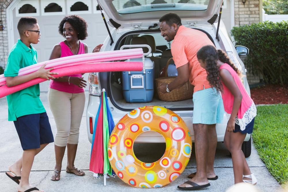 Ready for summer: a family get packed up. But take care to avoid the worst of the traffic.