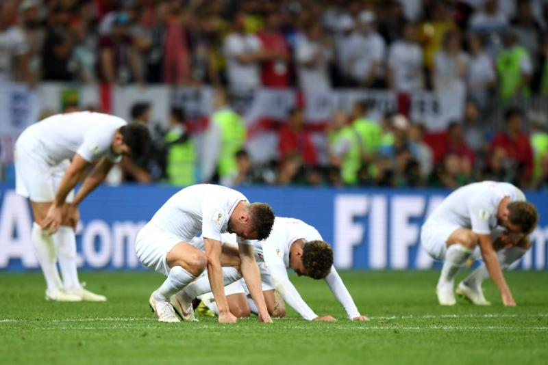 Jamie Vardy and Dele Alli of England look dejected after the final whistle.
