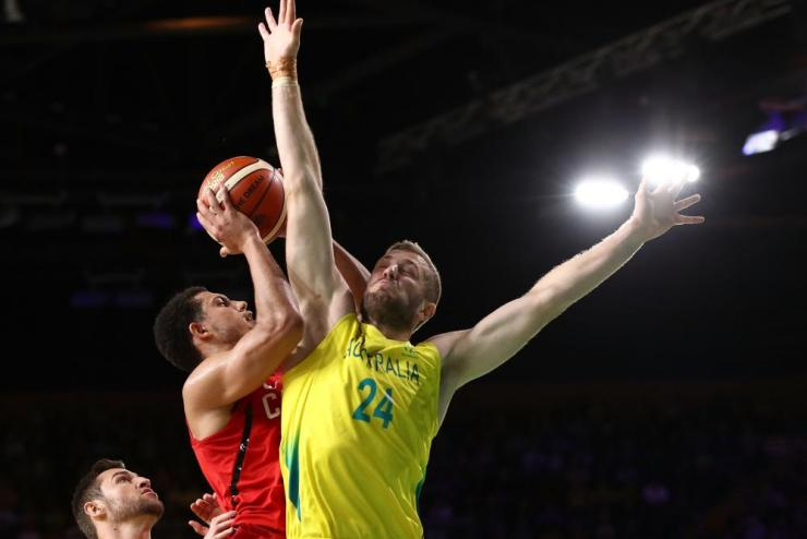 Canada forward/guard Ammanuel Diressa (4) and Australia forward Jesse Wagstaff (24) compete during the Men's Gold Medal Basketball Game between Australia and Canada on day 11 of the Gold Coast 2018 Commonwealth Games.