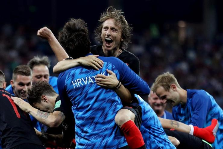 Luka Modric celebrates with teammates following their victory.