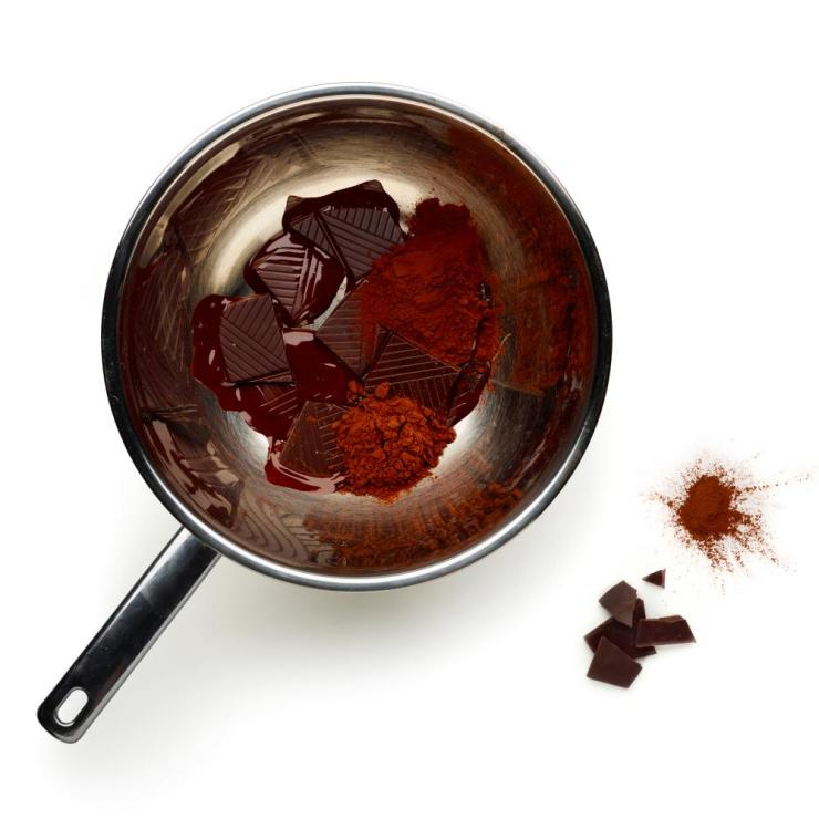 Melt the chocolate with the cocoa in a bowl over a pan of simmering water.
