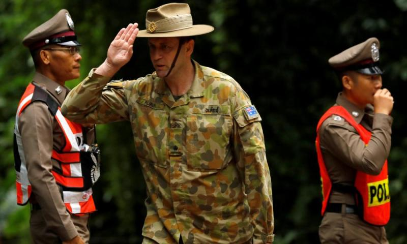 Australian military personnel outside the cave.