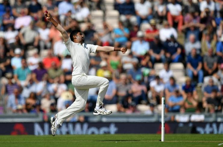 Jasprit Bumrah of India steams in before unleashing the ball.