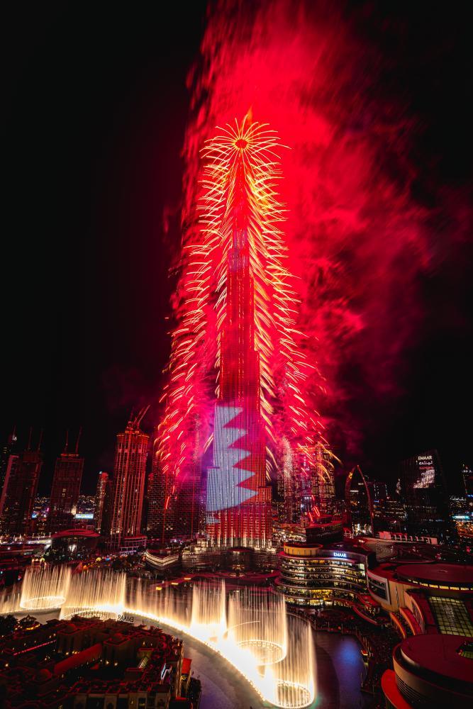 Fireworks go off at the Burj Khalifa.