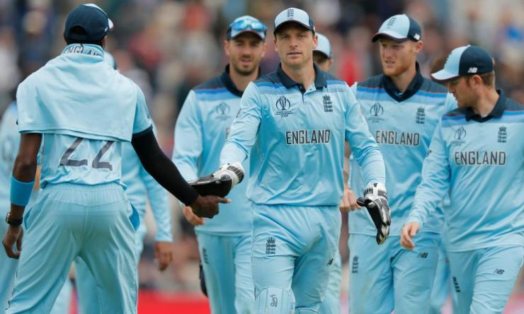 Jos Buttler and the England players leave the pitch.