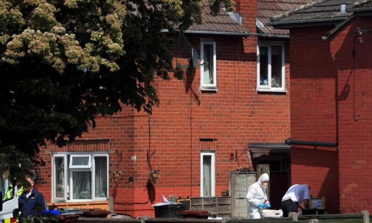 Police forensic investigators at an address in Elsmore Road