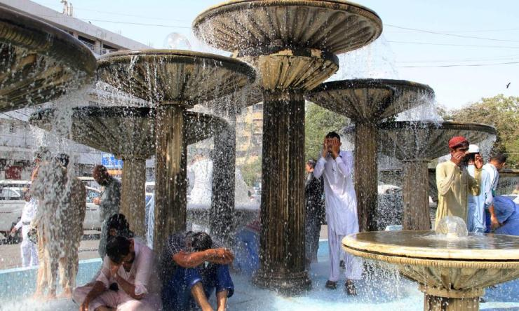 People try to cool off during a heatwave in Karachi, Pakistan