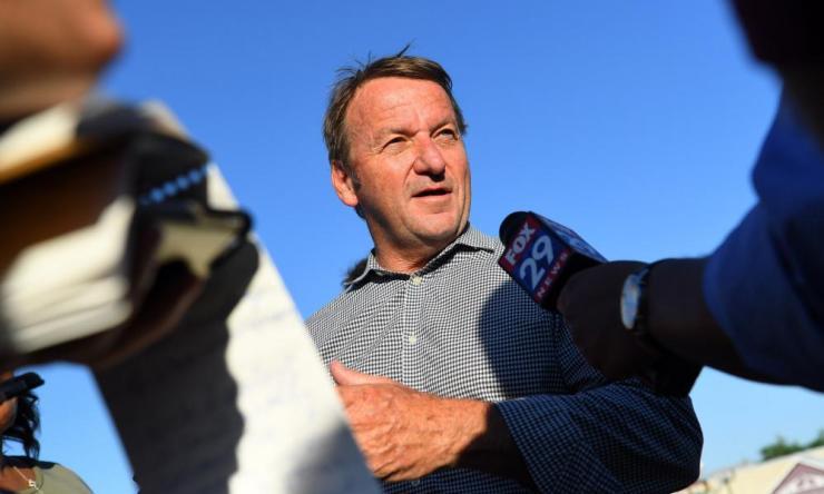 Annapolis mayor Gavin Buckley speaks to media across the street from Capital Gazette building earlier today.
