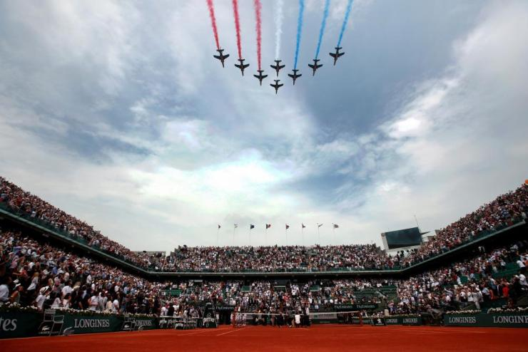 "The ""Patrouille de France"" flies over the court Philippe Chatrier in honour of Roland Garros."