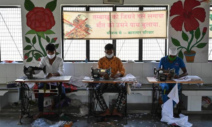 Prisoners making masks in Kaushambi district of Uttar Pradesh, on Monday, 13 April 2020.