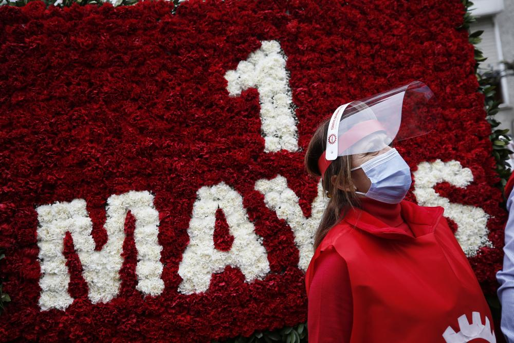 A trade unionist stands in front of the May Day wreath that she and others had hoped to place in the square, the site of a massacre of protesters on May Day in 1977