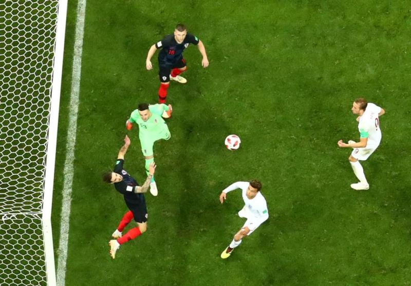 Croatia's Sime Vrsaljko clears the ball off the line after a header from England's John Stones.