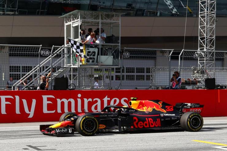 Verstappen crosses the finish line to take the chequered flag and win the race.