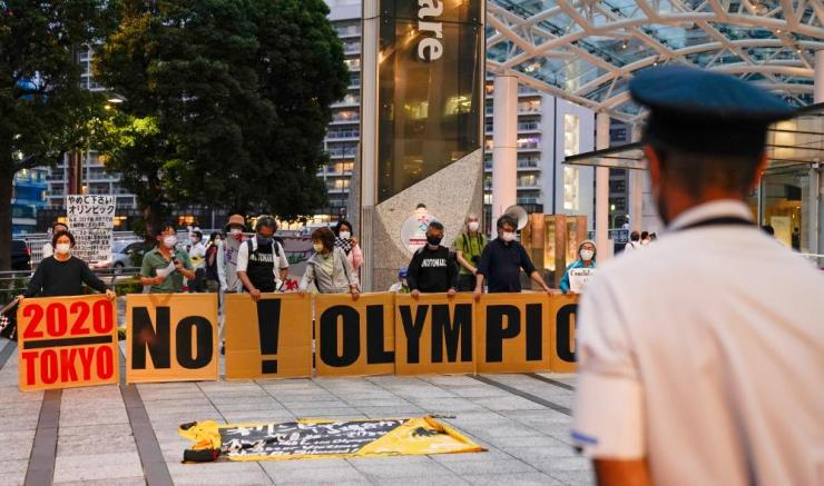 Demonstrators protest against hosting the Tokyo 2020 Olympic Games.