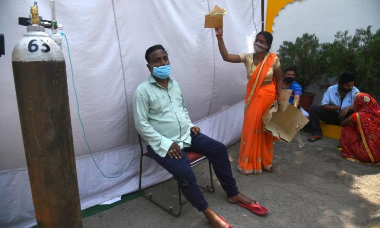 A suspected Covid-19 patient receives oxygen supply at a Sikh shrine, or gurdwara, where oxygen is made available for free by various Sikh religious organizations in New Delhi, India. The country has reported a record number of 400,000 new Covid-19 cases in one day.