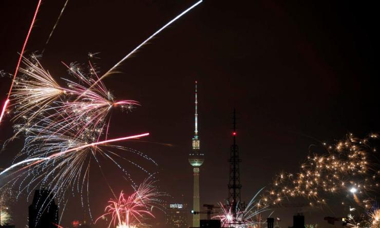 Fireworks explode near Berlin's TV tower.