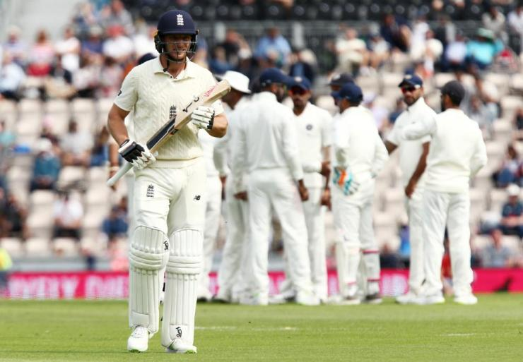 Jos Buttler leaves the field looking dejected after being caught out by Virat Kohli off the bowling of Mohammed Shami.