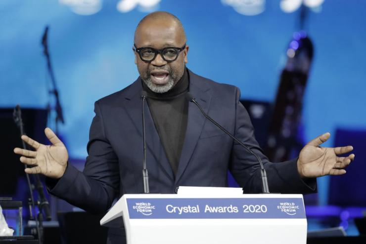 Artist Theaster Gates, from the United States, addresses the audience after receiving a Crystal Award.
