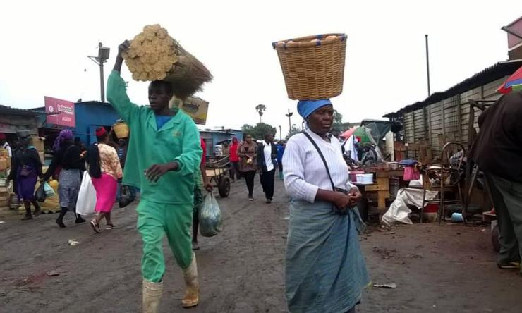 People walk in a market in the Zimbabwean capital Harare.