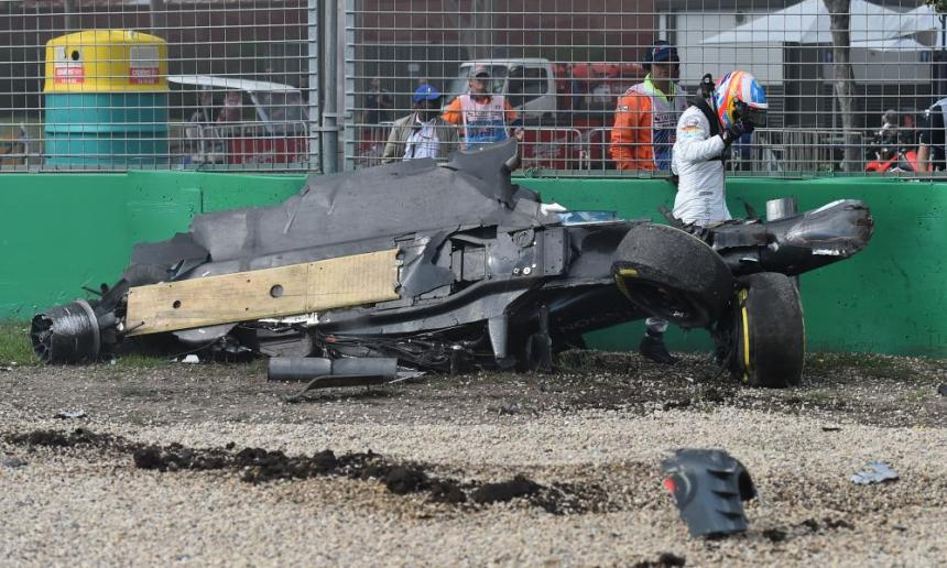 McLaren driver Fernando Alonso of Spain emerges from the wreck of his car after he collided with Haas driver Esteban Gutierrez of Mexico.