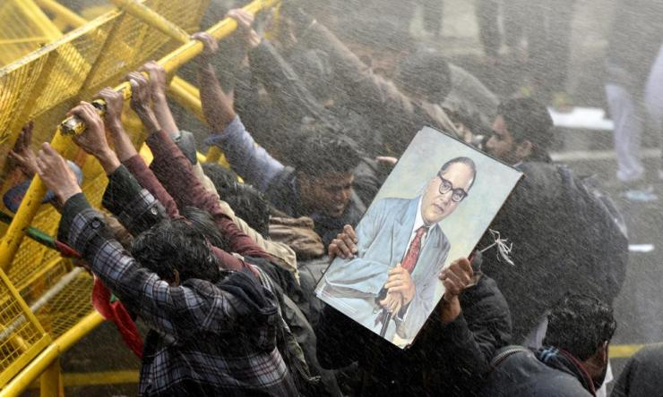 Police use water cannon on protesters demanding the resignation of the Hyderabad University vice-chancellor over the suicide of Dalit scholar Rohith Vemula.