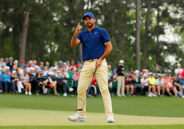 Jason Day of Australia celebrates after making a putt for birdie on the 18th