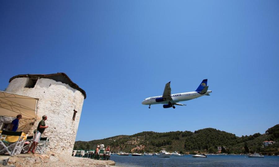 A Thomas Cook charter jet flies into the Greek island of Skiathos. Bookings to Greece are up 40%.