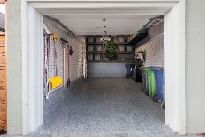 How much would it cost to turn a 2 car garage into bedroom for 2 1 2 car garage cost