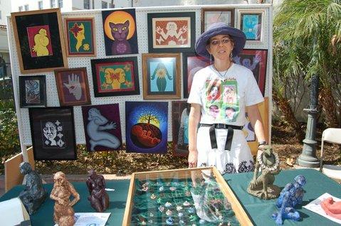 Client and peer arts teacher Lesley Grogan with her art display.
