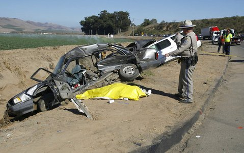 Law enforcement officials examine a fatal two-vehicle accident at Dominion and Foxen Canyon roads east of Santa Maria involving a late model Honda and a Cadillac Escalade. Three people were involved, one was killed and the other two reportedly have minor to moderate injuries.