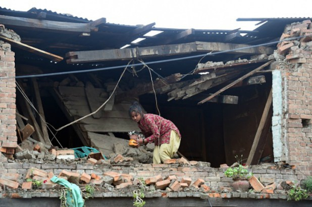 A young girl in broken nepal home