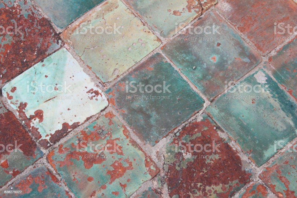 https www istockphoto com photo antique green ceramic floor tiles gm638275022 114348299